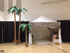 Standard pop up tent with added fabric and sheets and baskets and rugs. Add a fake palm tree and you are in Israelite camp! Vbs 2014 at ogletown baptist church, Newark de