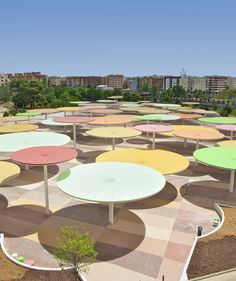 The Centro Abierto de Actividades Ciudadanas (CAAC) in Córdoba, Spain, an open center of civic activities, has been decorated with steel umbrellas to provide color from above and shade to those underneath.  The project was created by Madrid architects Paredes Pino.  - photo from thegrid