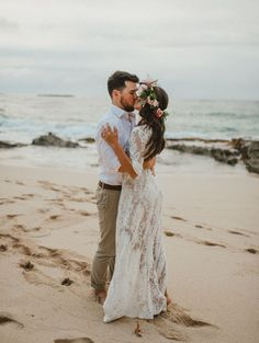 He surprised his darling with a beach photoshoot... And an engagement ring! Teaming up with Wayfair for beachy boho furniture rentals and décor, she wore a pink and peach floral crown and gorgeous lace bohemian dress.