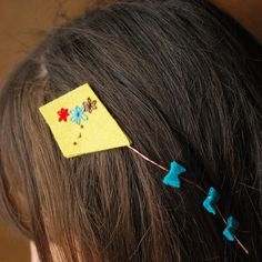 The awww factor is off the charts with this super cute embroidered kite hair clip (@ Wild Olive)
