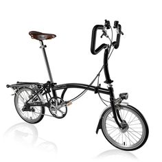 Designers and makers of the iconic Brompton Folding Bike. Create your dream Brompton using our custom bike builder or learn more about the benefits of a Brompton folding bicycle. Custom Bike Parts, Custom Bikes, Bicicleta Brompton, Bike Builder, Folding Bicycle, Bicycle Shop, Online Bike, Bicycle Accessories, Bicycle Design