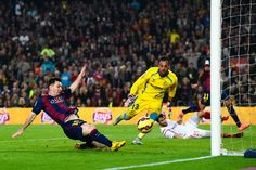 Lionel Messi of FC Barcelona scores his team's fourth goal during the La Liga match between FC Barcelona and Sevilla FC at Camp Nou on November 22, 2014 in Barcelona, Catalonia. Lionel Messi beat the number of goal in the Spanish La Liga of Telmo Zarra scoring his 252nd goal.