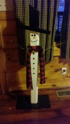 DIY snowman made from landscape timber