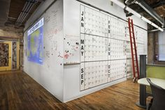 Idea Paint wall includes a giant year-long calendar (+ ladder and track). I would have reorganized it by quarter.