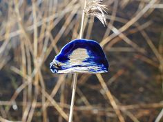 Järvi (lake in Finnish) collections third brooch out of ten is deep blue and it looks like the moon or sun is reflecting the surface of lake with the leaf gold detail and for that we have a word Kajo. Hand made unique art piece.