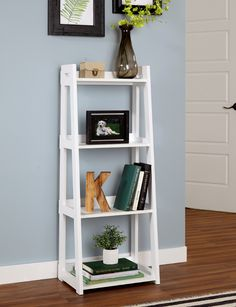 No tools needed! Get all your books and keepsakes #organized in no time with our new, easy-to-assemble Ladder Bookshelves! #LadderBookshelf #LivingRoom #HomeOrganization