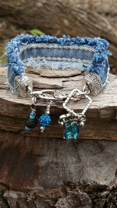 Check out this item in my Etsy shop https://www.etsy.com/listing/485108486/frayed-denim-dangling-charm-bracelet