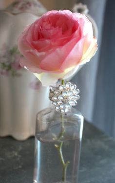 @My Romantic Home. Love this single bloom in an old bottle with some bling - gorgeous