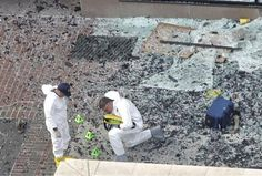 The photo above shows investigators in hazmat suits placing evidence numbers on the shattered glass and debris as they investigate the scene of the first bombing outside Marathon Sports.  FBI Special Agent Jeff Rolands just testified 458 pieces of evidence were recovered from that location. Tsarnaev Boston Marathon Bombing Trial | WCVB