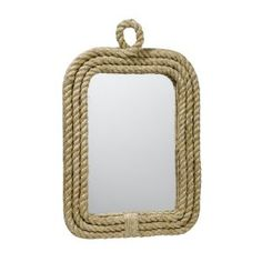 Put cheap rope from Home Depot on my ugly bedroom mirror! Love the natural texture