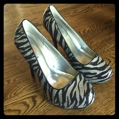 Charlotte Russe Silver and Black platforms 5 1/2 inches beautiful platform heels. Barely worn and Nothing wrong with them. Charlotte Russe Shoes Platforms