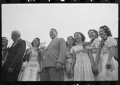 [Untitled photo, possibly related to: Winner of largest family contest, National Rice Festival, Crowley, Louisiana] Crowley, Siblings, Louisiana, Brother, Rice, Statue, Laughter, Sculptures, Jim Rice