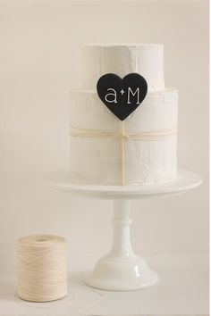 Love how simple this wedding cake is, not girly at all.