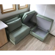 This sectional has 2 storage seat units and one sleeping unit. #tinyhouse TranscendTinyHomes.com/