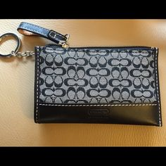 Coach Change Purse w/keychain Coach Change Purse w/keychain in signature logo and black leather. Never used. No tags Coach Accessories Key & Card Holders