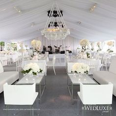 This all white wedding reception is so #luxe! We love the chic decor.