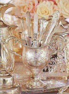 This is an elegant idea for a shabby chic buffet. Use silver and crystal vases or containers to hold the sliverware.