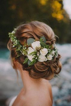 elegant updo wedding hairstyle ideas with greenery floral #wedding #weddinghairstyels #bridalfashion