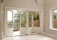 White timber bifold doors, internal open