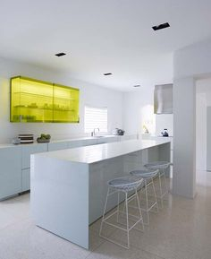 The kitchen is really where I took the most risk in terms of decorating. The color of the cabinets is soft blue but yet still very impactful. A solitary upper cabinet in yellow transparent glass also offers an unexpected touch of color.