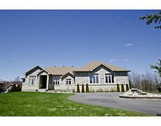 This incredible custom bungalow backs on to the Emerald Links golf course & has majestic views.Built in 2011,this home enjoys fine finishings & dramatic architectural detailing.There are 10 ft.-2 ft.