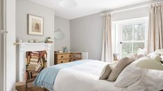 Stunning Master Bedroom at Kitty's Cottage in St. Agnes complete with compact shower room. Bedroom has been furnished with handmade linen curtains and cushions. Pure wool blanket throw on bed. Vintage books hide out in the fireplace. Compact Shower Room, Boutique Retreats, St Agnes, Boutique Interior, Slow Living, House Goals, Small Spaces, Master Bedroom, Cornwall