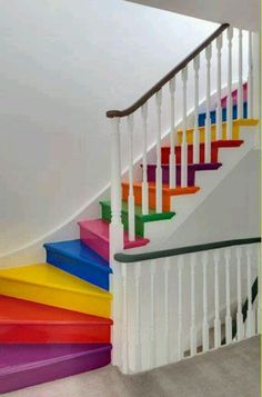 This is a brilliant idea for sprucing up a sometimes neglected area - colour your stairs for a statement (and rainbow!) look.