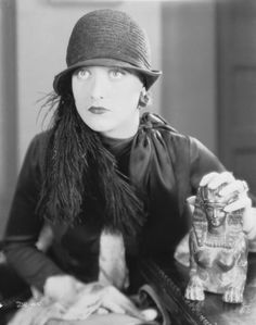 Joan Crawford fondles an Egyptian statuette in 'Paris' directed by Edmund Goulding 23rd March 1926