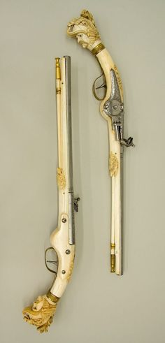 Pair of wheellock pistols. Date: ca. 1655–65. Culture: Dutch, Maastricht. Medium: Steel, chiseled and engraved; gilt brass; ivory. | © 2000–2014 The Metropolitan Museum of Art.:
