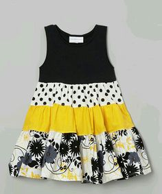 Yellow & Black Polka Dot Tiered Dress - Infant, Toddler & Girls by Carolina Kids With a playful mix of prints twirling across its tiered skirt, this sunshiny dress blossoms with sweet style. Its cotton construction and roomy fit will keep little ladies lo Frocks For Girls, Kids Frocks, Little Girl Outfits, Little Girl Dresses, Kids Outfits, Girls Dresses, Frock Patterns, Girl Dress Patterns, Toddler Dress