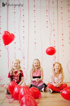 Love the red balloons. Simple and pretty backdrop for photo shoot.