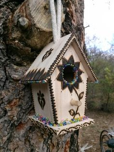 Wood burning, pyrography, bird house, beads.