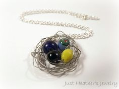 $23 - www.etsy.com/shop/JustHeathersJewelry - Bird's nest necklace - crinkled wire wrapped - OOAK - black, blue, yellow, & painted beads - birdnest - robins egg nest - gift idea. Use coupon code PINS15 for 15% off your total purchase.