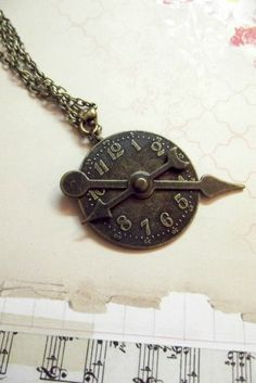 Clock and spinners necklace - bronze color metal