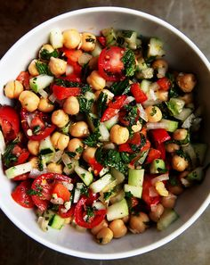 This light and fresh chickpea salad features tomatoes, and cucumbers.