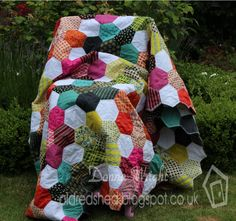 Old Red Shed: Denyse Schmidt fabric quilt using sizzix 2 1/4 inch hexagons...