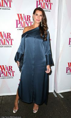 Simply stunning: Brooke Shieldslooked gorgeous in a loose and silky off-the-shoulder dress with double slitat the opening of Broadway play War Paint in New York on Thursday evening