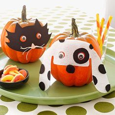 Adorn your tabletop with one of our pet projects: a pair of trick-or-treating pumpkins.