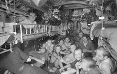 Crewmembers of German U-boat U-73 in a rare moement of relaxation. U-73 was sunk in the Med in December 1943 by two US destroyers. Thirty six of her complement perished and 16 were rescued by the American vessels.