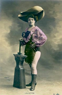 Look at my hat… now look at my anvil…    1910s tinted postcard!