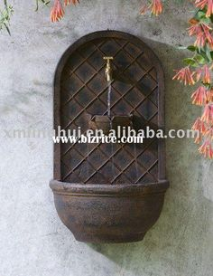 Handwashing and plant watering by front door    http://www.bizrice.com/upload/20120121/tap_wall_fountain_outdoor_water_fall.jpg