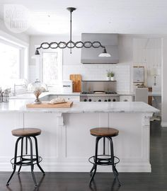 Kitchen design: White Carrara marble countertops {PHOTO: Robin Stubbert}