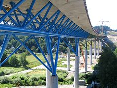 composite bridge with concrete slab over a steel truss, supported by ultra-slender columns