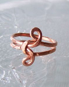 This simple little infinity love knot ring is done in bright hammered copper wire. Ring Size 8.5 This is a OOAK ( one of a kind ) and is ready to