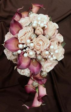 Beautiful Fushia Calla Lilies with Pale Pink Roses accented with some jewels! add some purple Calla Lillies, red roses, lavender and a blue flower and maybe a butterfly will be set