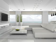 Fabulous all white modern living room with spectacular view and large screen TV