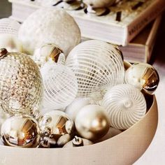 A mix of decorative ornaments displayed in a bowl is a simple solution for a centerpiece, or on an entry table