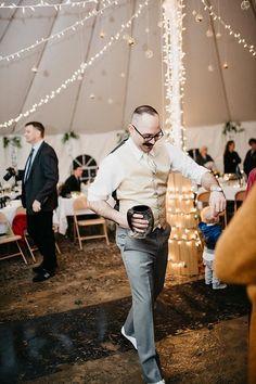 Groomsman dancing in April, Idaho, Tent wedding. Christmas rope string lights. Ivy, wisteria, white, gold, ivory, gray, green. hobby lobby globes. Fun. Buffalo horn mug as groomsman gift. Such fun! Photo Credit: Sloan Olivia Photography South Jordan, Utah