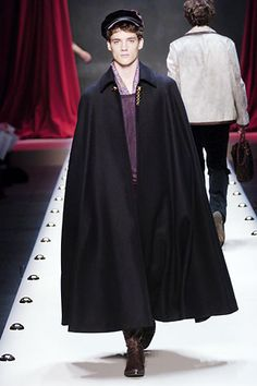 This Louis Vuitton piece resembles a cope which was a voluminous cape that  was worn by priests.