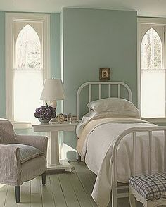 guest bedroom - love the way they created and arch in the window that was not there...great illusion